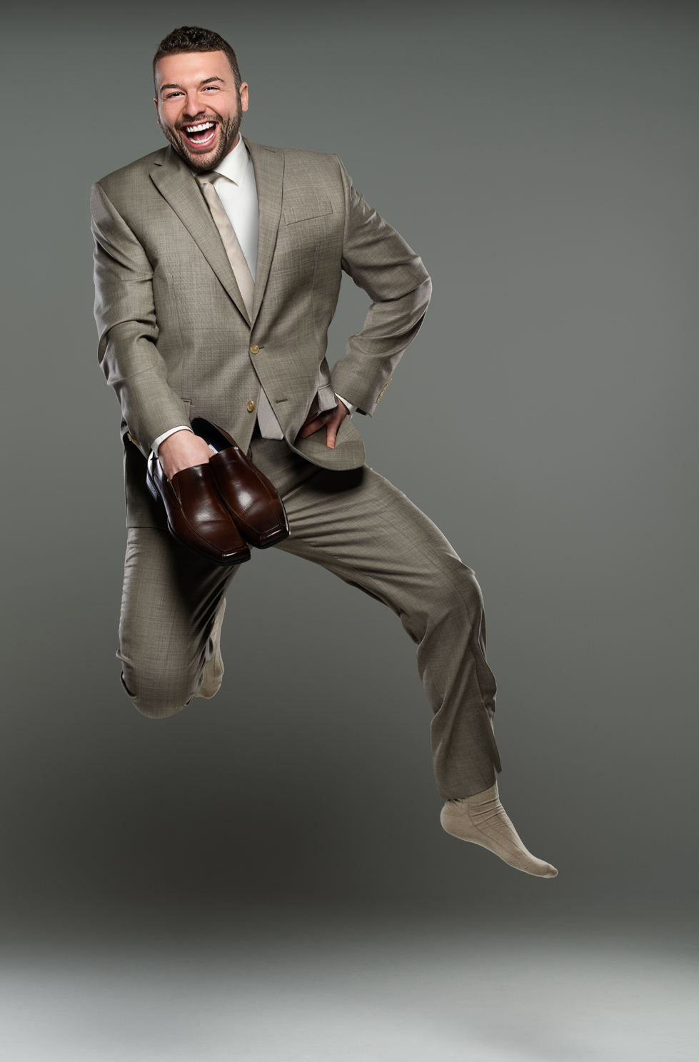 fashion photo of suits and shoes in a photography studio