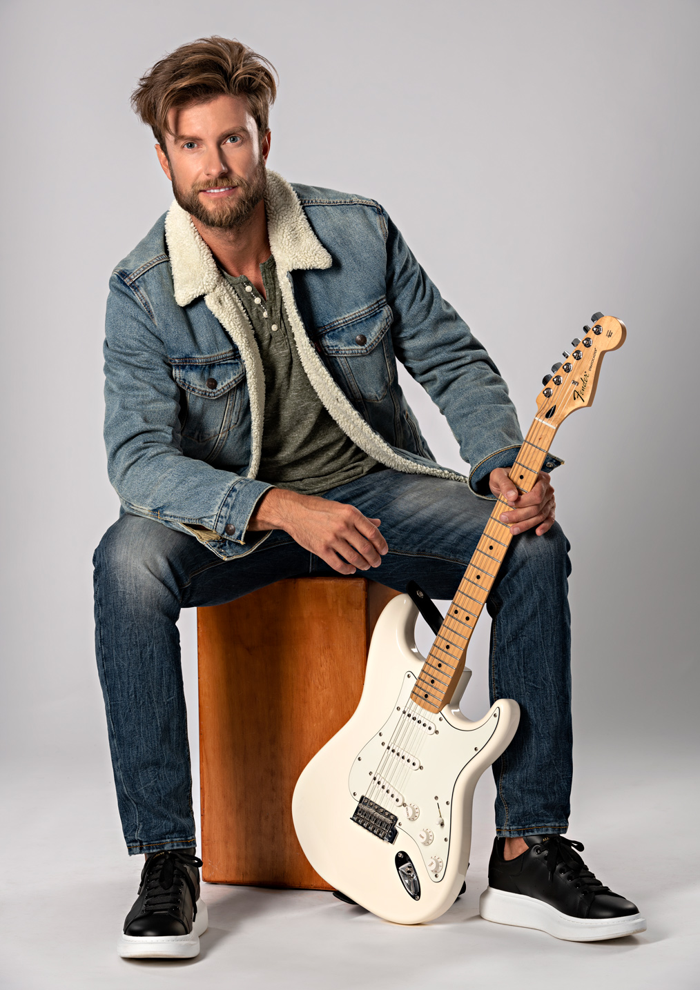 musician with a guitar for social media website