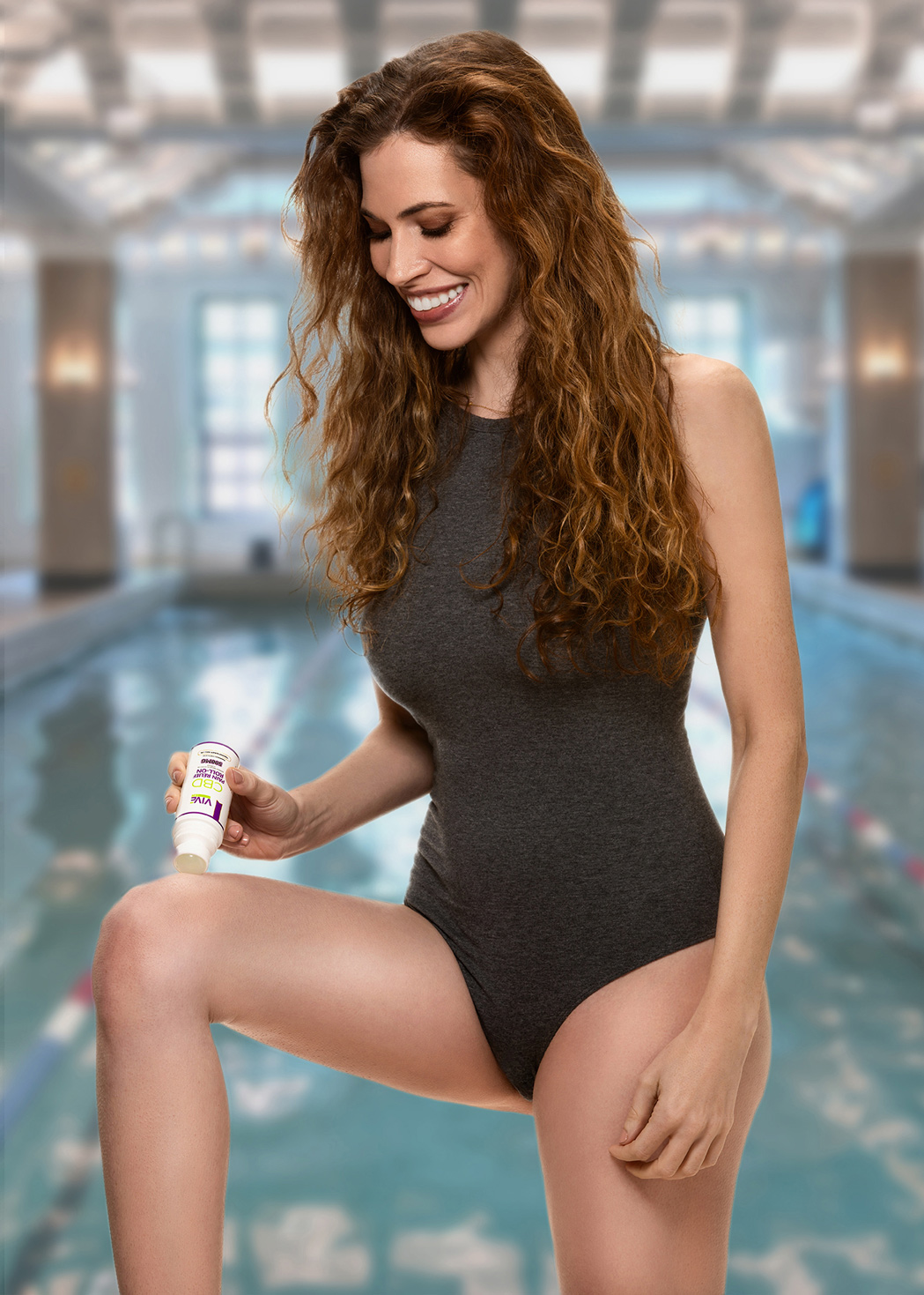 professional model with product at swimming pool