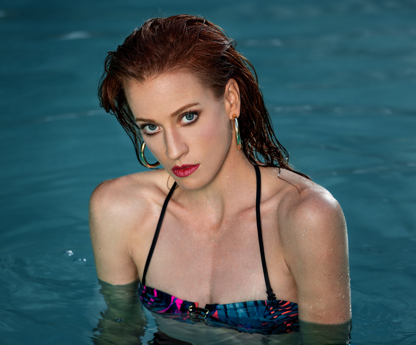 headshot of model in swimming pool