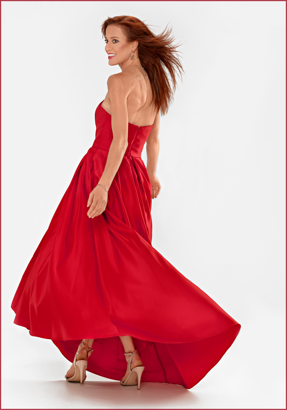 model in red high fashion dress
