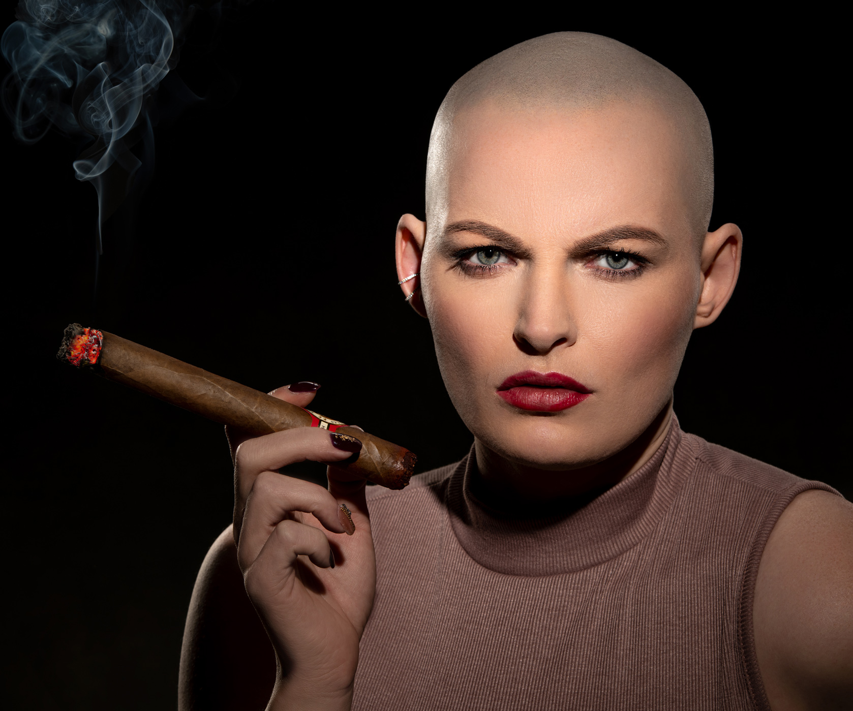 professional headshot of bald female model with cigar