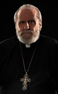 headshot of priest clergy preacher minister