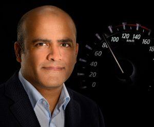 headshot of an automotive executive